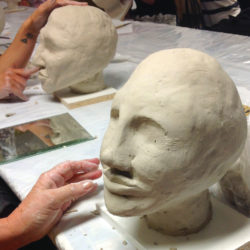 creation of a portraiture bust in clay