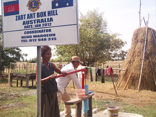 Cambodians using one of the water wells that were donated to their village.